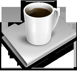 Kaffeetasse auf zugeklapptem Laptop